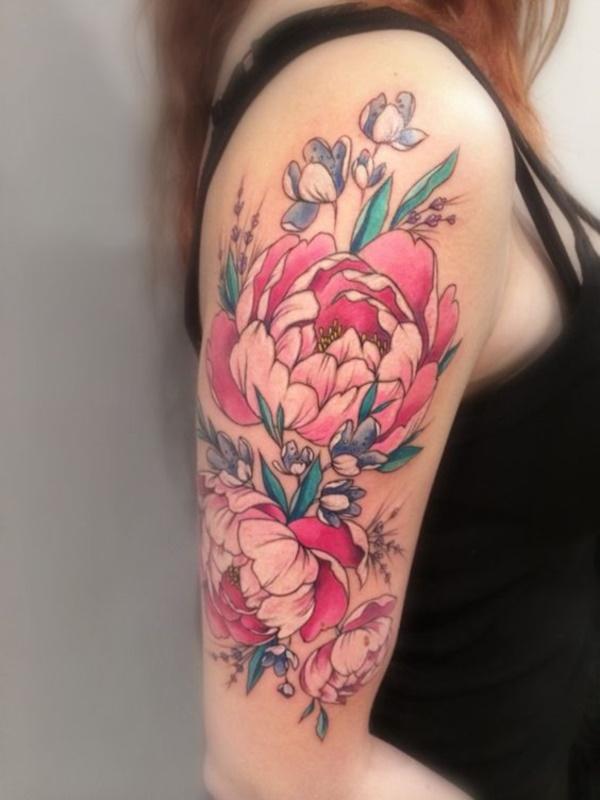 tatuagem de flor colorida no braço